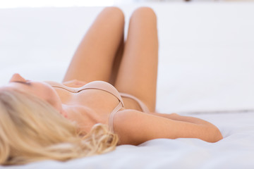 Woman in lingerie lying on the bed