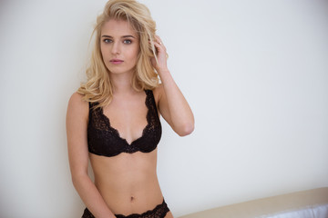 Blonde girl in lingerie looking at camera