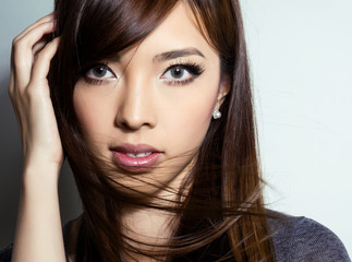 portrait of beautiful young asian woman with clear, flawless skin and perfect make-up