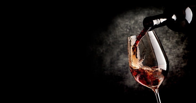 Pouring wine on black