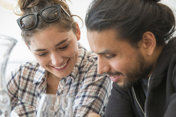 Couple sitting in restaurant looking at menu