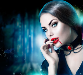 Beautiful halloween vampire woman portrait. Beauty sexy vampire