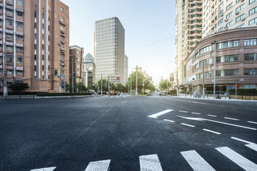empty asphalt road of a modern city with skyscrapers Wall mural
