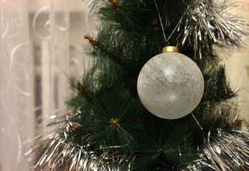 Toy on the Christmas tree - ice ball