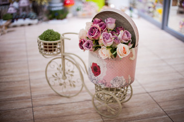 Rose flower in the basket bicycle