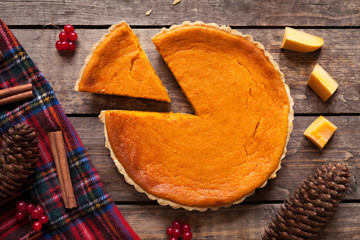 Homemade sliced pumpkin tart pie recipe with cinnamon and nuts