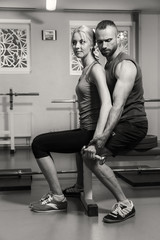 Sporting a young couple in the gym. Healthy Lifestyle. Women's and Men's Fitness. Work on your body. Photos for sporting magazines, posters and websites.