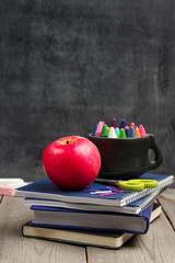 Crayons (pencils) in a mug with chalkboard