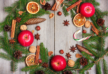 Christmas decoration with fir tree, oranges, cones, spices, appl