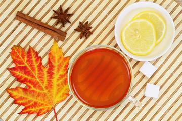 Autumn leaf, cup of tea, lemon, star anise and cinnamon