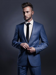Handsome stylish man in blue suit