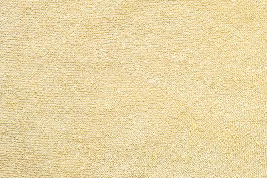 Closeup yellow napkin fabric background