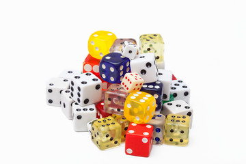 A pile of old dice in a variety of sizes and colors