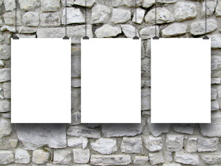 Three vertical frames with clips on ancient medieval stone wall background