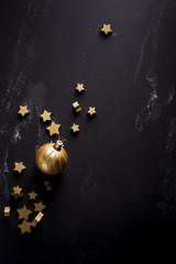 Christmas ornaments on black background