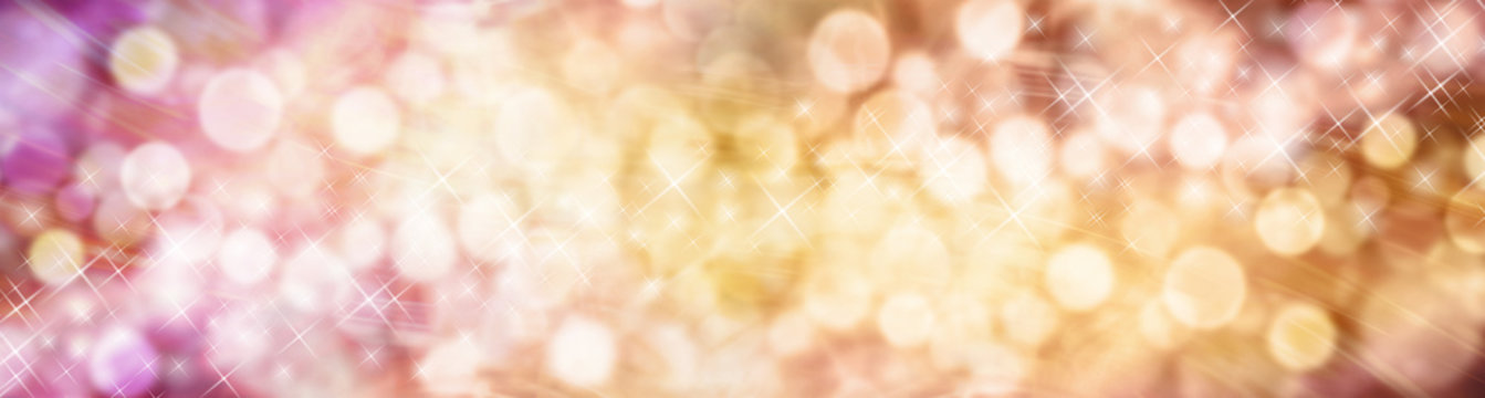 Beautiful autumnal bokeh sparkly website header - Wide multicolored bokeh background with a random scattering of different sized sparkles meandering from left to right