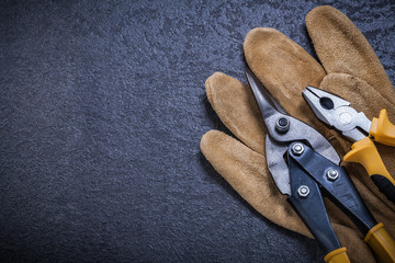 Sharp tin snips pliers leather safety glove construction concept
