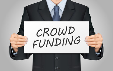 businessman holding crowd funding poster