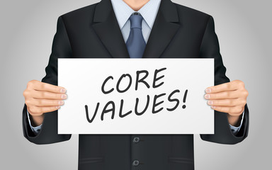 businessman holding core values poster
