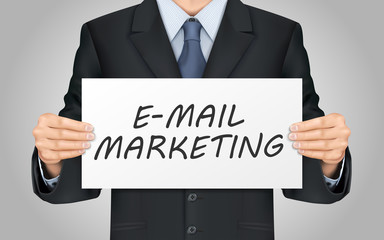 businessman holding email marketing poster
