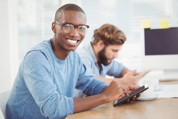 Portrait of happy man using tablet