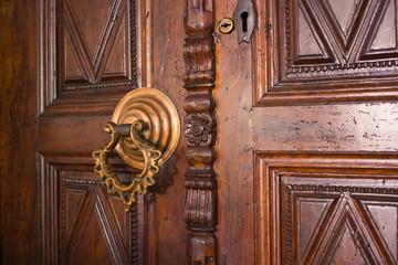 old door with ornate handle