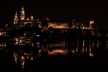Krakow at night. Wawel Castle and Wisla.