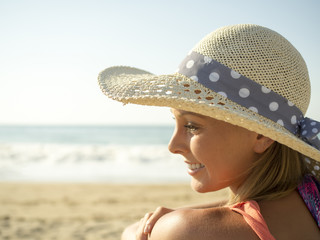 happy girl smiling portrait in the beach  a picture hat with the sea and horizon in the background
