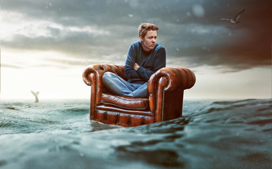 Man on a seat lost at sea