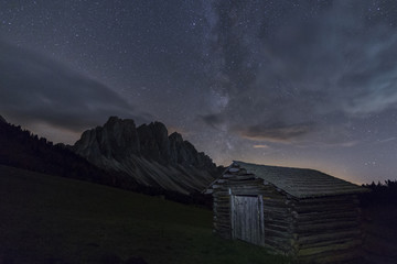 The Milky Way in the starry sky above the Odle, Funes Valley, South Tyrol, Dolomites, Italy, Europe