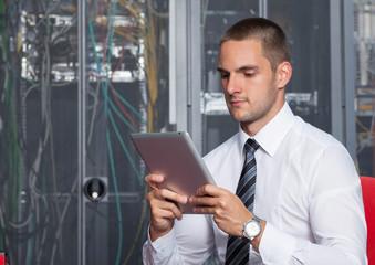 businessman using tablet server room