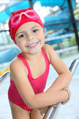 Portrait of 4-year-old girl bathing in swimming pool