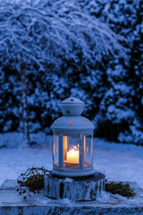 Lantern in garden, winter evening