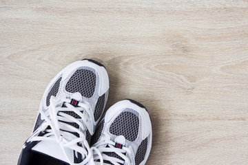 Sport shoes on the wooden floor