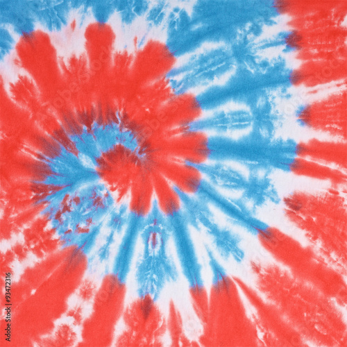 Wall mural close up shot of red, white and light blue color tie dye fabric texture background in square ratio