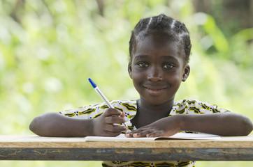 Young African Schoolgirl Writing Doing her Homework