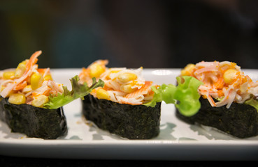 Three pieces of sushi on a plate