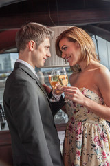 Young couple in love making a toast