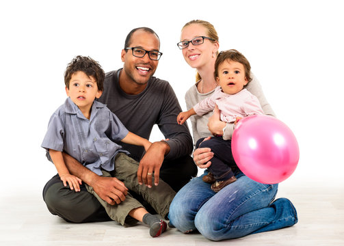 Happy interracial family isolated on white