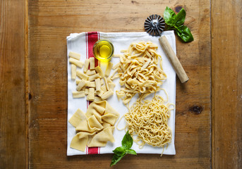 different types of fresh pasta on kitchen towel. spaghetti, nood
