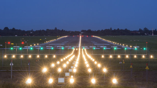 airport takeoff and landing area at evening