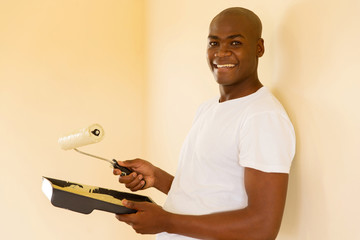 young african man painting new home