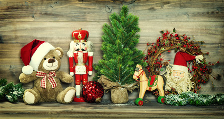 Christmas decoration. Vintage toys Teddy Bear, rocking horse