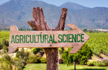 Agricultural Science wooden sign with rural background