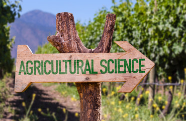 Agricultural Science wooden sign with farm background