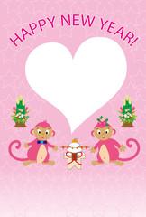 可愛いピンクの猿とハート形フォトフレーム年賀状