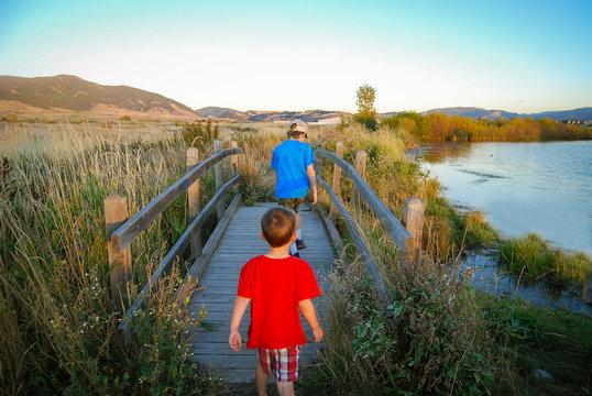 Boys walking over a foot bridge