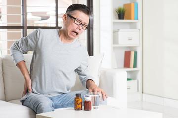 Mature Asian man hip pain