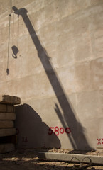 Shadow of a Large Crane with Piledriver and Slabs Visible