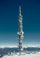 Communications tower on a high snowy mountain